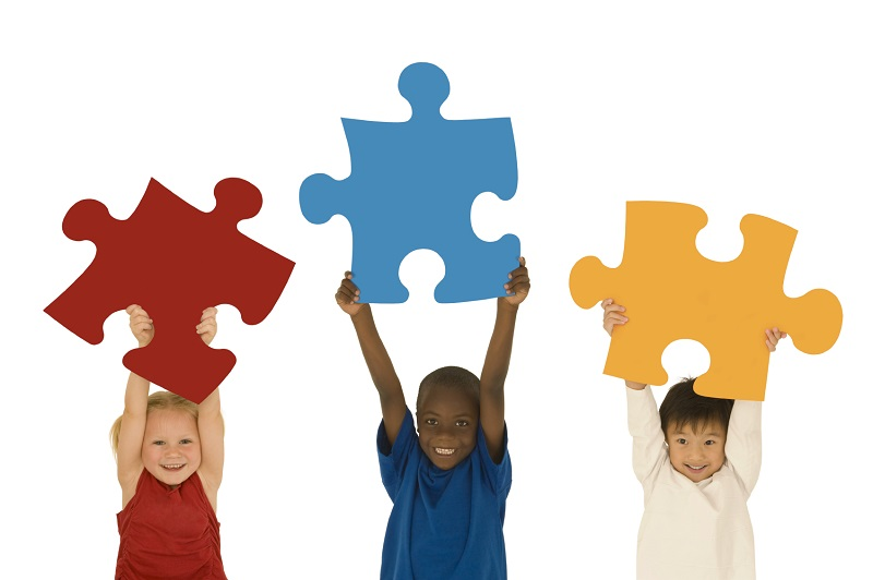 Children holding puzzle pieces