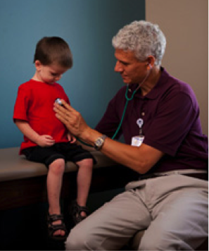 Doctor using a stethiscope on a child