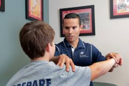 Sports Performance Technician holding childs rotator cuff and arm